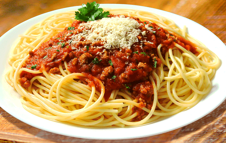 A vegan spaghetti bolognese topped with our grated hard italian Sheese