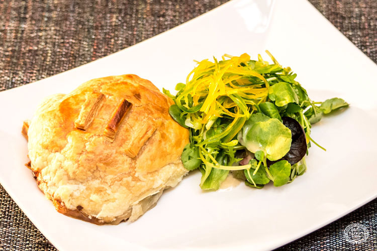 A vegan mushroom, cranberry & Smoked Cheddar Sheese en-croute
